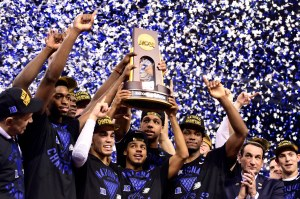 Apr 6, 2015; Indianapolis, IN, USA; Duke Blue Devils guard Quinn Cook (middle) and teammates hoist the NCAA championship trophy after defeating the Wisconsin Badgers in the 2015 NCAA Men's Division I Championship game at Lucas Oil Stadium. Mandatory Credit: Bob Donnan-USA TODAY Sports