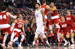 Wisconsin bench celebrates as Kentucky's Willie Cauley-Stein walks off after the NCAA Final Four tournament college basketball semifinal game Saturday, April 4, 2015, in Indianapolis. Wisconsin won 71-64. (AP Photo/David J. Phillip)