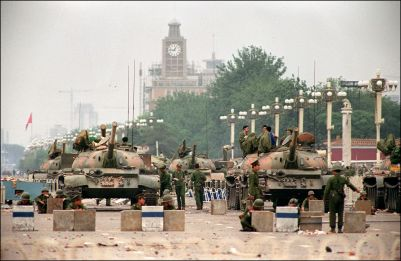 The People's Liberation Army  (PLA) tanks guard a